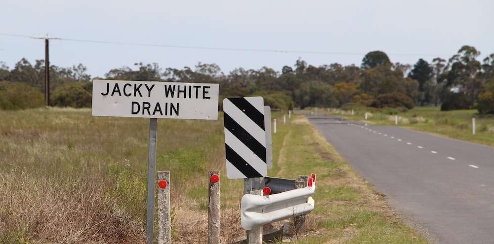Jacky White Drain sign